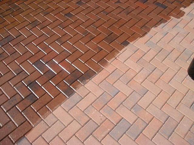 pressure washing a brick patio